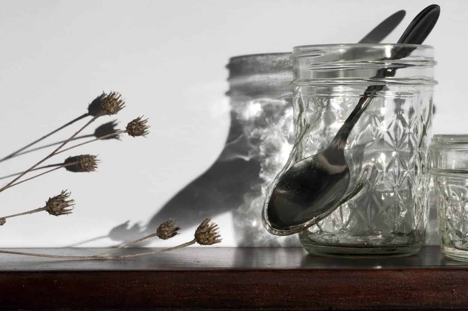 """What's good for the goose is good for the gander,"" Jelly jars, cutlery, dried flowers, wood frame, 22.5 x 29 x 4 inches, photo credit: Elizabeth Torgerson-Lamark"