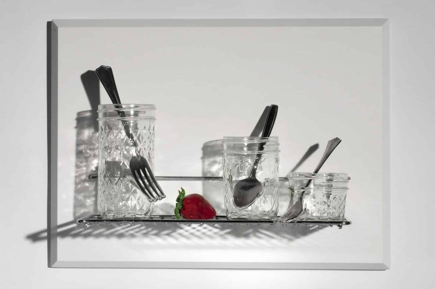 """From small beginnings come great things,"" Jelly jars, cutlery, flame worked glass, stainless steel, 12 x 16 x 6 inches, photo credit: Elizabeth Torgerson-Lamark"